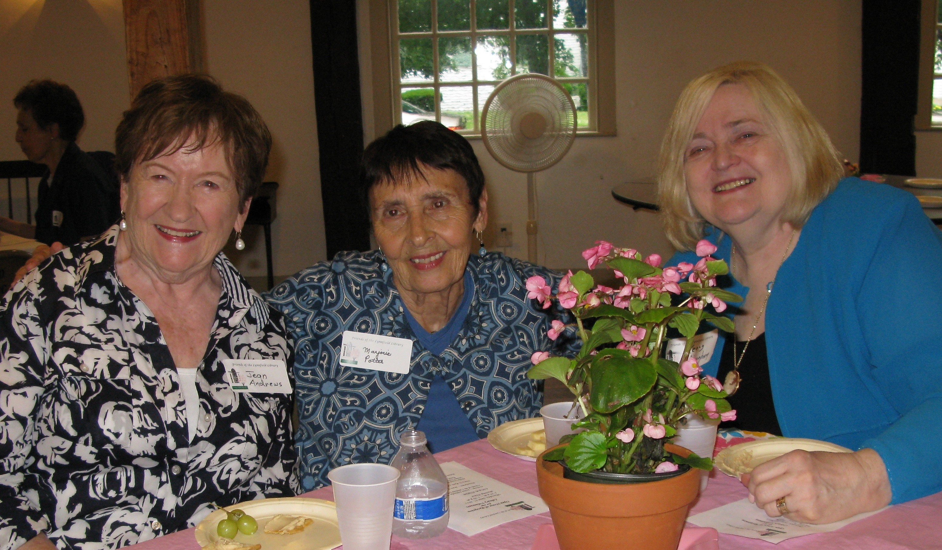 Library Volunteers Jean Andrews and Marjorie Potter with Library Trustee Kerry Haughney